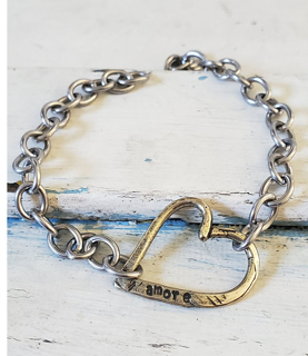 Chunky chain amore heart bracelet on white wood trunk