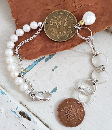 Artisan Old coin bracelet with pearls and chain on wood