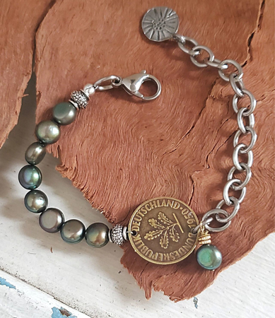 Green pearl chunky chain old coin bracelet on wood