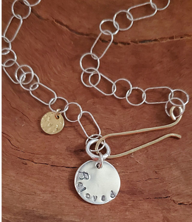 Beloved Charm silver & gold necklace on wood