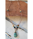 Turquoise black tan gemstone copper loop necklace on wood