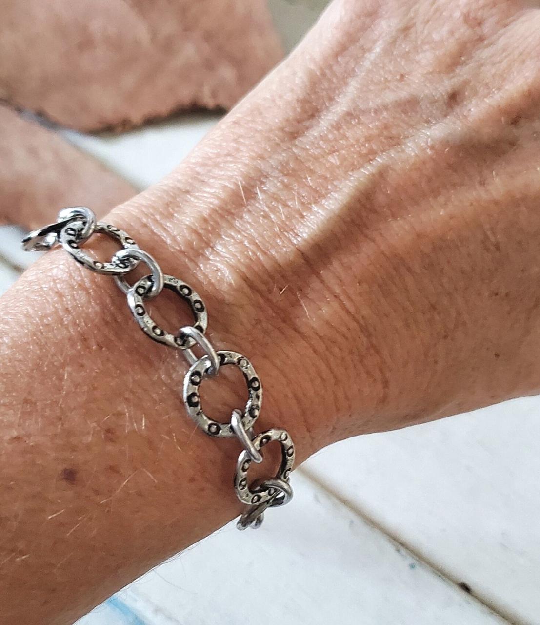 Silver circles bracelet on wrist