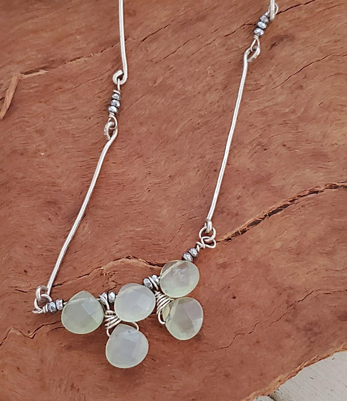 Silver stick mint green gemstone artisan necklace on wood