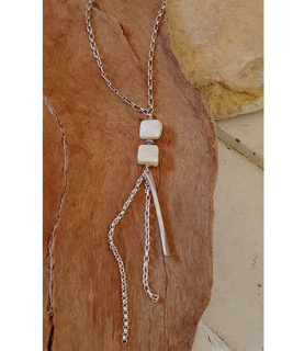 Pearl long silver chain necklace on wood