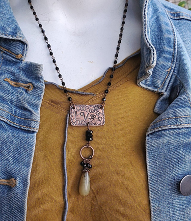 copper love tag necklace on mannequin