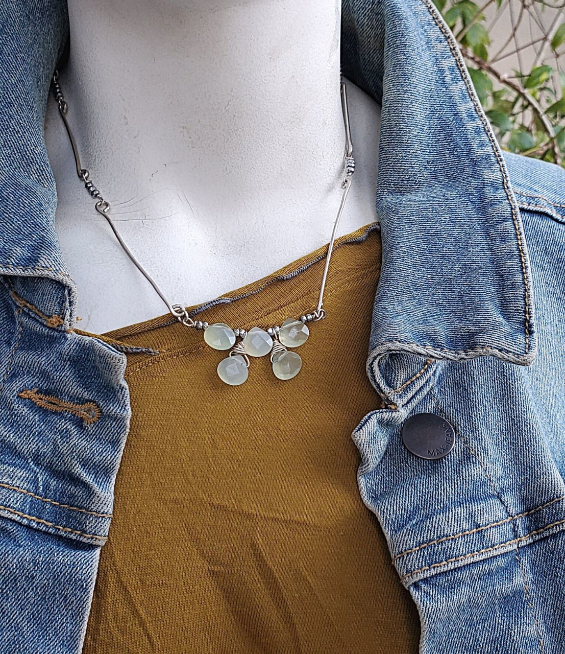 Mint green stone silver bar necklace on mannequin with jean jacket