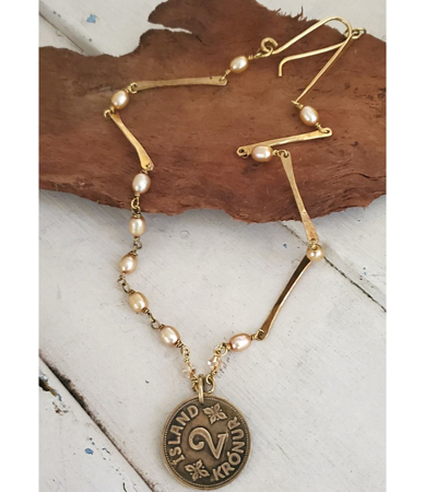 1941 Iceland coin necklace with pearls on wood