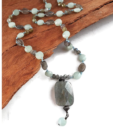 Casual blue gray gemstone necklace on wood