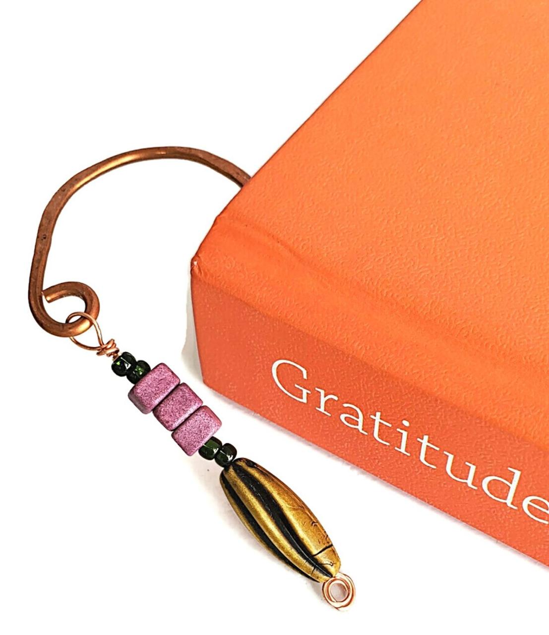 Artisan copper purple green bead dangle book mark in book