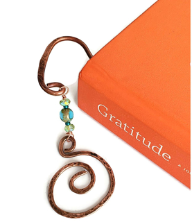 Artisan copper spiral blue and green crystal book mark in book