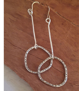 Silver stick hoop earrings on wood