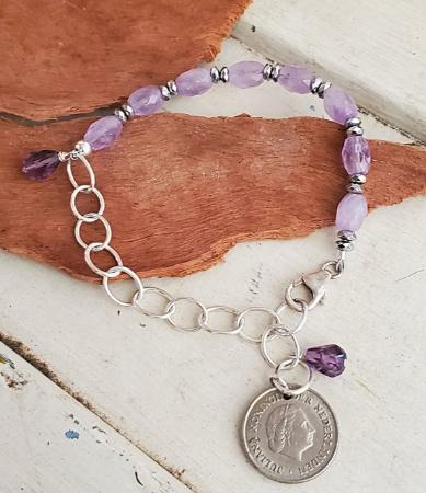 Purple stone on a Netherland coin bracelet
