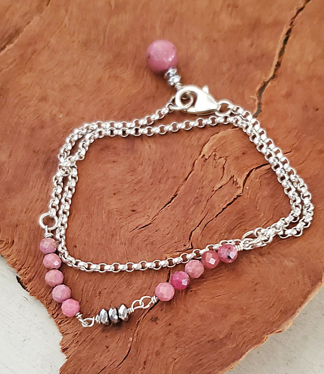 pink gemstone silver rolo chain bracelet on wood