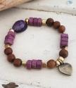 Purple gemstone heart bracelet on white trunk