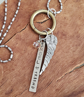 Angel wing chain silver necklace on wood