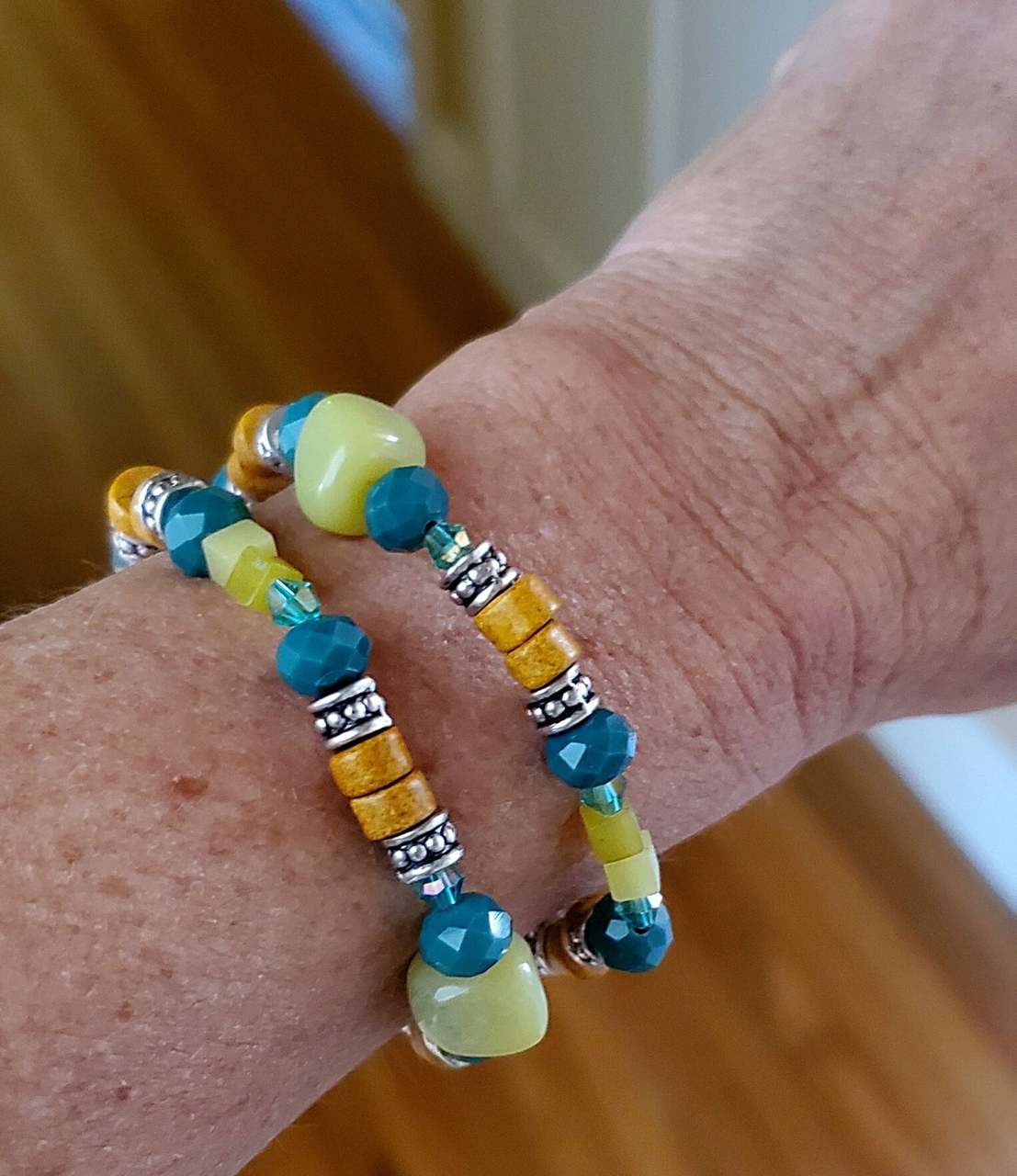wearing multi green gemstone and crystal stretch bracelet stack on arm
