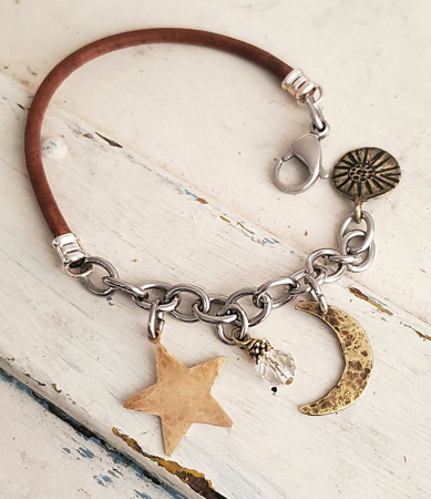 moon star crystal leather chain bracelet on white trunk