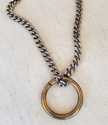 brass ring thick silver curb chain necklace on white background