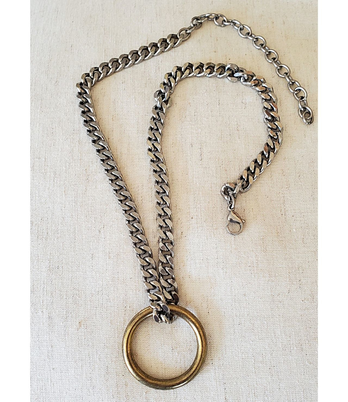 Cool brass ring thick silver curb chain necklace on white background