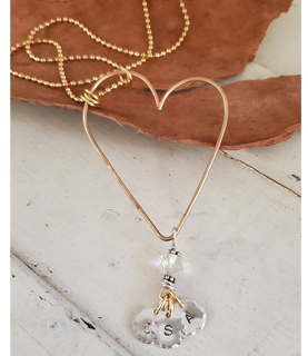gold Open heart charm necklace on white and wood