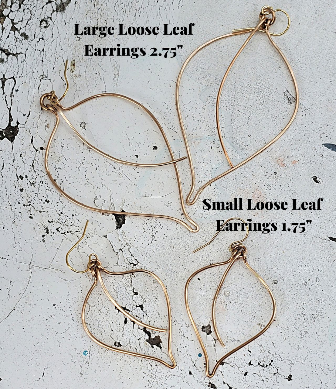 comparison chart of loose leaf earring on white distressed wood
