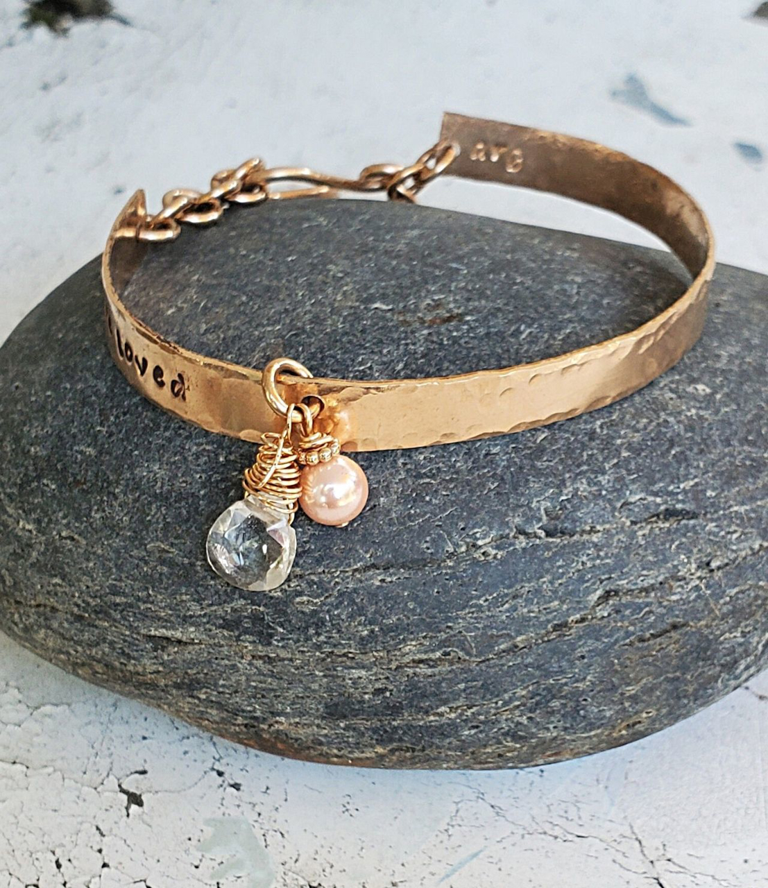 You are Loved bronze pearl crystal bracelet on white distressed wood