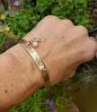 wearing You are Loved bronze pearl crystal bracelet on wrist