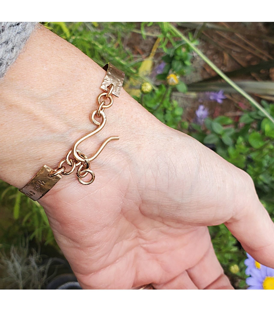 backside of You are Loved bronze bracelet with hook clasp