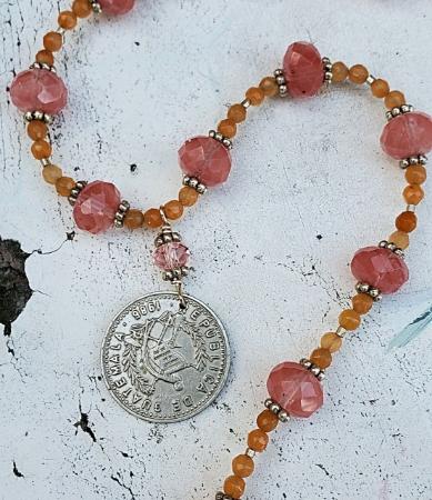 orange pink gemstone silver Guatemalan coin necklace on white