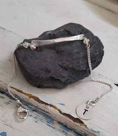 Silver bar initial tag charm birthstone bracelet on black rock