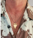wearing a bronze metal  arrowhead silver chain necklace