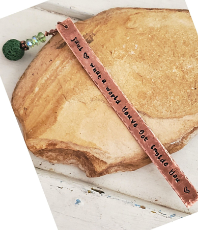 copper rectangle bookmark with quote and green beads