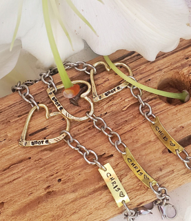 3 heart name tag remembrance bracelets with white flower on wood