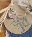 round copper charm stamped with new baby birthdate