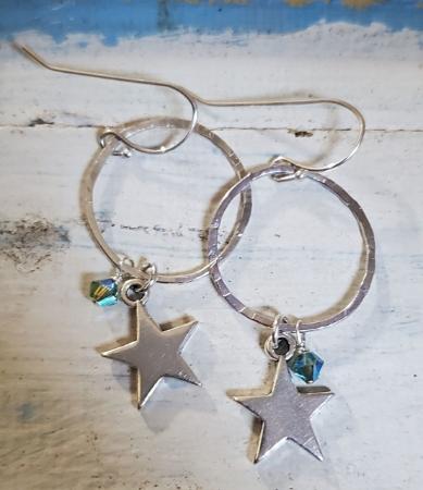 Silver Star hoop crystal earrings on white wood
