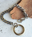 Hefty silver chain gold oring bracelet on table