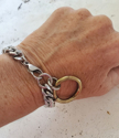 silver chain gold oring bracelet on wrist