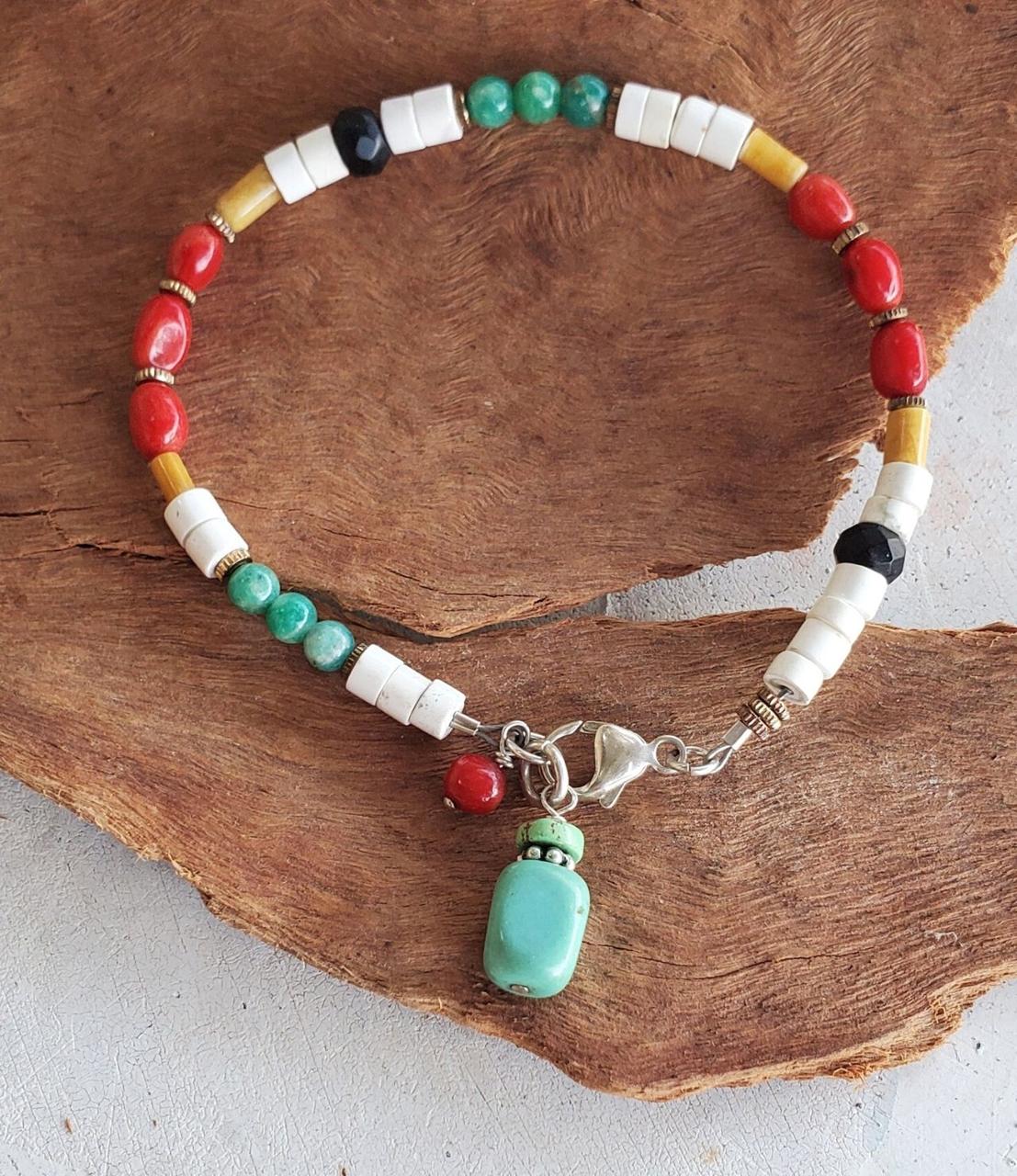 multi color gemstone silver clasp bracelet  on wood
