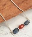 close up blue orange gemstones of necklace on wood