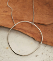 Silver chain open circle necklace on wood