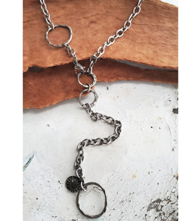 Long silver chunky chain circles necklace on wood