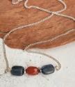 Blue orange gemstone silver chain necklace on wood