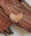 handcrafted bronze heart silver chain necklace on wood