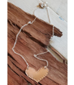 bronze heart silver chain necklace on wood