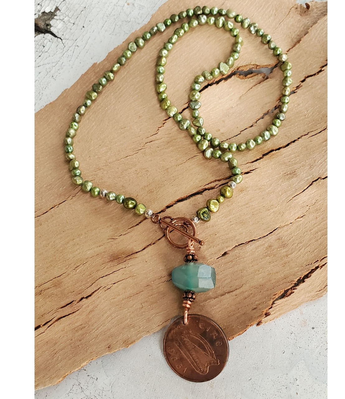 old vintage coin green pearl teal gemstone necklace on wood