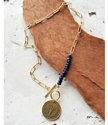 Old coin blue gemstone gold chain necklace on wood
