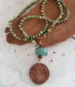 Ireland coin green pearl teal gemstone necklace on wood