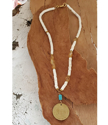 yellow  & white gemstone Argentina coin necklace on wood