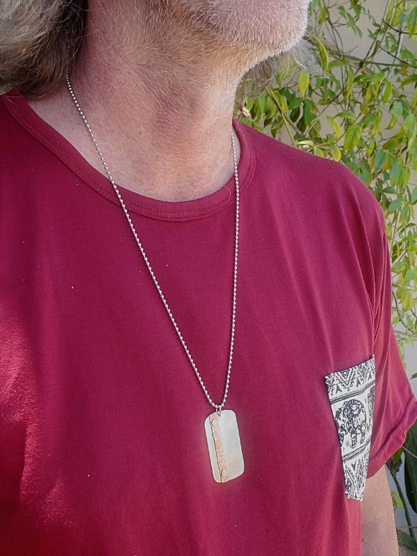 artisan dog tag necklace worn on male