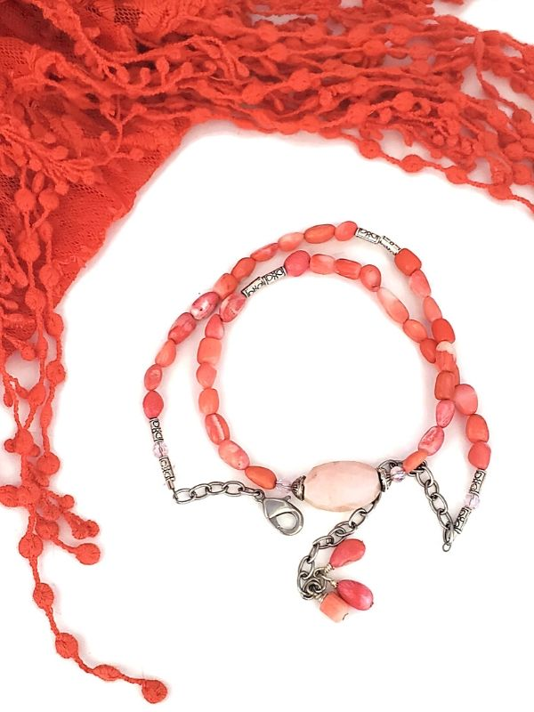 A Summer scarf and bracelet in coral pink